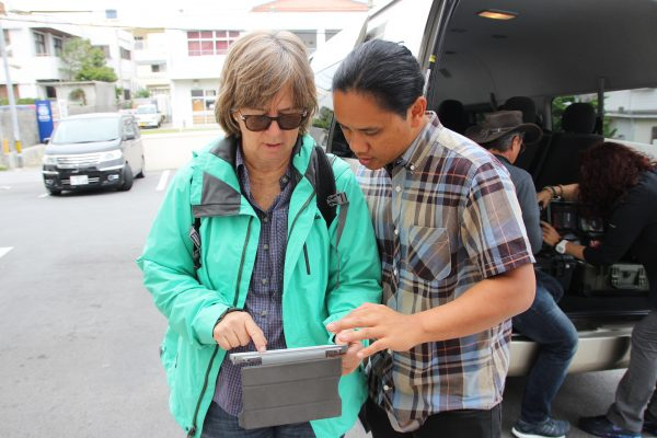 Co-producer and veteran filmmaker Heather Haunani Giugni with director Ty Sanga — working, of course.